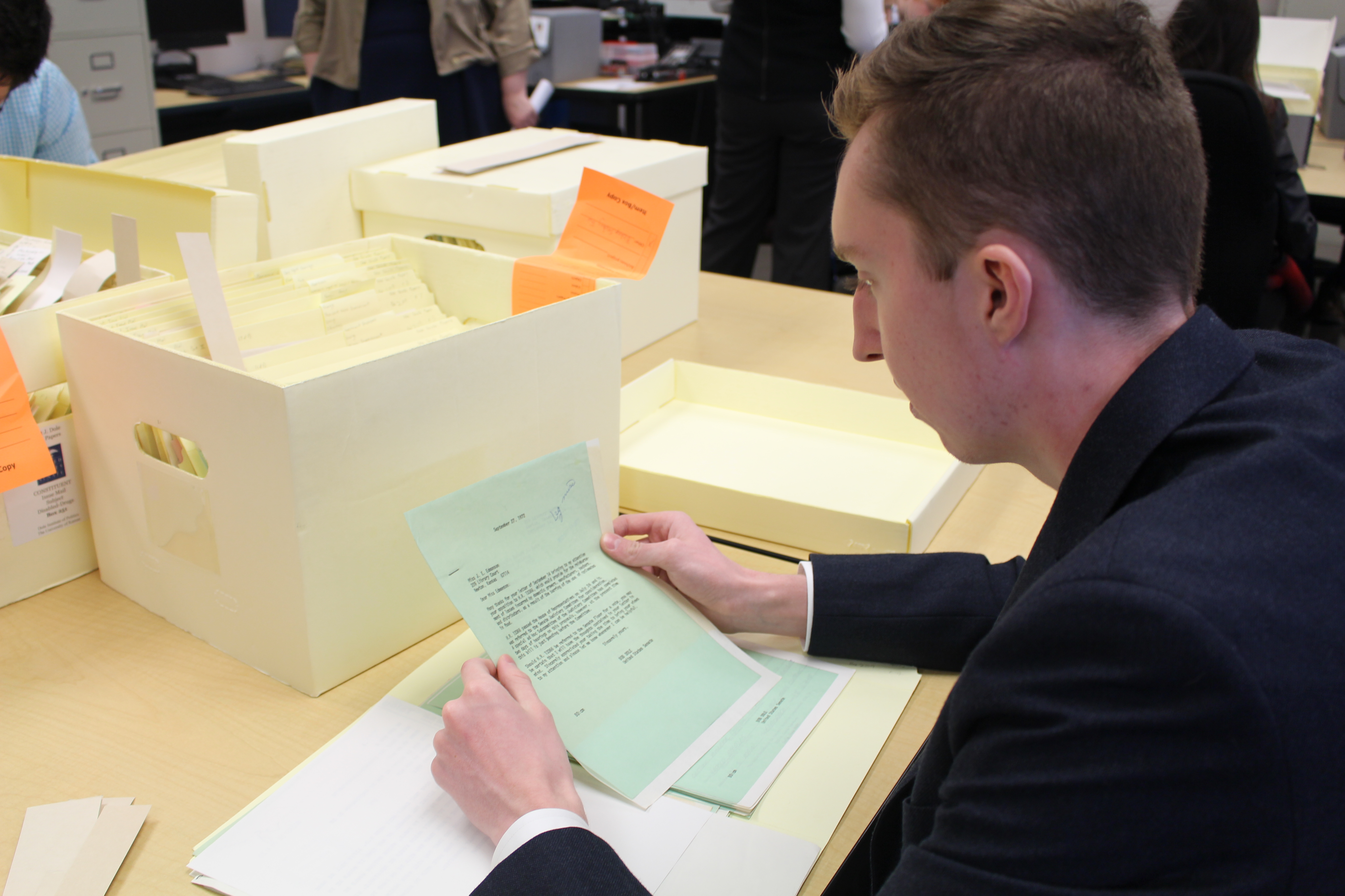 A student researcher reads through archival materials